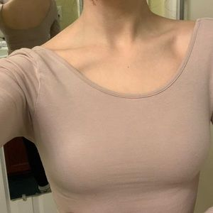 Tight, light pink shirt